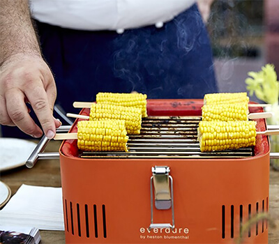 Image of Everdure Cube Portable Charcoal BBQ in Orange
