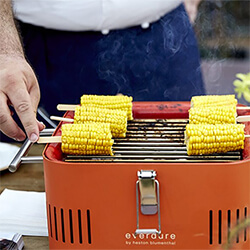 Small Image of Everdure Cube Portable Charcoal BBQ in Orange