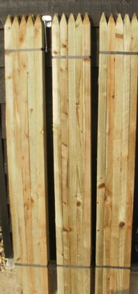 Image of 10 x 1.5m (5ft) 32mm x 32mm square & pointed pressure treated tree stakes