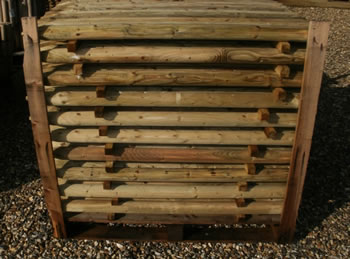 Image of Pack of 10 1.2m (4ft) tall, 50mm diameter treated Wooden Fence Posts