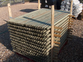 Image of 10 x 1.8m tall x 40mm diam. round wooden fence posts stakes pressure treated