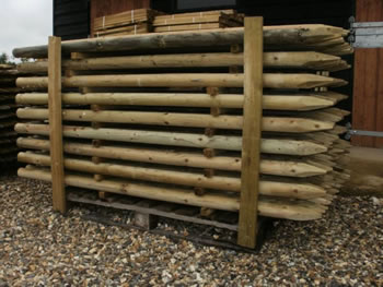 Image of 10 X 1.65m (5ft 6') tall x 60mm Round Wooden Pressure Treated Fence Posts wood