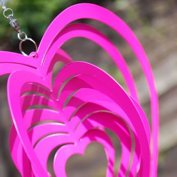 Extra image of Bold Pink Heart Shaped Steel Garden Windspinner