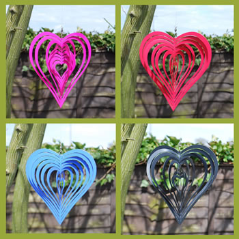 Extra image of Set of Four Coloured Heart Shaped Windspinners for Home or Garden
