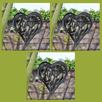 Extra image of Set of Three Black Heart Shaped Steel Garden Windspinners