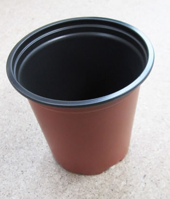 Image of 50 Mixed 9cm & 13cm Round Modiform Plastic Plant Pots: drainage holes