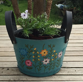 Image of Nutley's Small Round Blue Recycled Tyre Planter with Handles Hand Painted