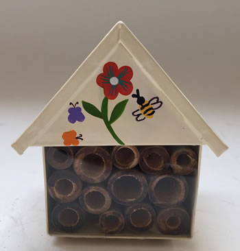 Image of Nutley's White Miniature Insect House with Flower Decoration Garden Outdoors