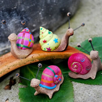 Extra image of Set Of Four Bright Coloured Resin Snail Garden Ornaments