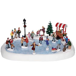 Small Image of Lemax Christmas Village - Village Skating Pond With Sound - Set of 18 - 4.5V Adapter (94048-UK)