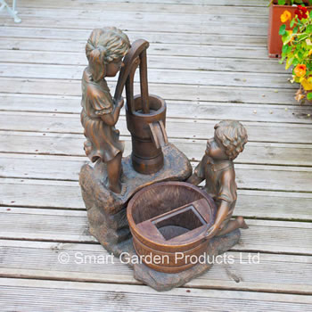 Image of Water Pump With Boy and Girl Figures - Solar Water Feature