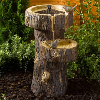 Image of Solar Power Tree Trunk Birdbath