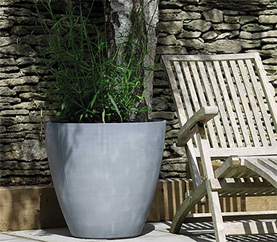 Image of Stewart 53cm Tall Round Beton Planter in Dark Grey
